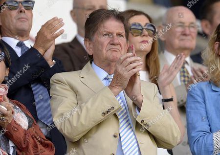 Reading Chairman Sir John Madejski during a minutes applauds in memory of Eamonn Dolan before the Sky Bet Championship match between Reading and Preston North End played at Madejski Stadium, Reading on August 6th, 2016