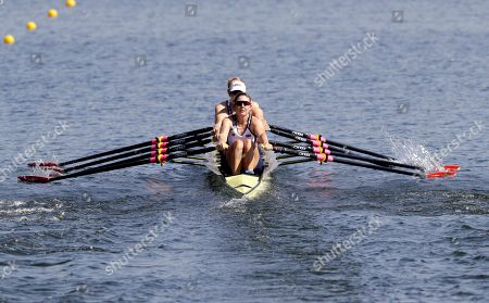 Grace Latz, Tracy Eisser, Megan Kalmoe, and Adrienne Martelli, of United States, compete in the women's quadruple scull heat heat during the 2016 Summer Olympics in Rio de Janeiro, Brazil