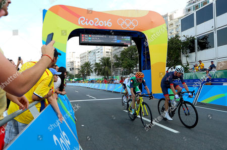 Ireland's Dan Martin finishes the race alongside Chris Froome of Great Britain