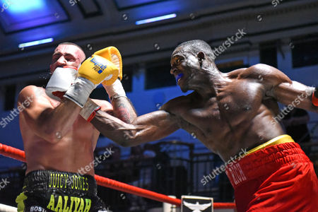 Richard Riakporhe (red shorts) defeats Jason Jones during a Boxing Show at York Hall on 6th August 2016