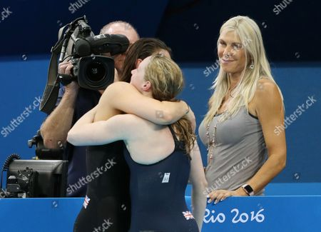 Swimming -Women's 400m   BBC 's Sharon Davies looks on as as Great Britain's Hannah Miley just misses out on a Bronze Medal in  Individual Medley FINAL pictured hugging fellow GB finalist Aimee Willmott  during day one of the Rio Olympics 2016 on the 6th August 2016