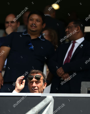 Leeds United owner Massimo Cellino sitting infront of QPR chairman Tony Fernandes during the Sky Bet Championship match between Queens Park Rangers and Leeds United played at Loftus Road, London on 7th August 2016