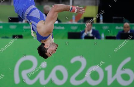 Britain's Kristian Thomas performs on the floor during the artistic gymnastics men's qualification at the 2016 Summer Olympics in Rio de Janeiro, Brazil