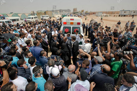 Egyptian mourners surround an ambulance carrying the coffin of Egyptian-American Nobel Laureate Ahmed Zewail during a public funeral ceremony at the site of a science academy founded by Zewail, in 6th of October city, near Cairo, Egypt, . Egypt bid farewell to Ahmed Zewail, the Egyptian-born scientist who won a Nobel Prize in 1999, according him a military funeral with full honors led by President Abdel-Fattah el-Sissi. Zewail, was a science adviser to President Obama who won the 1999 Nobel Prize for his work on the study of chemical reactions over immensely short time scales