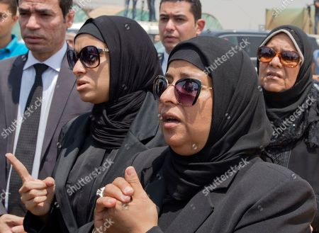 Relatives of Egyptian-American Nobel Laureate Ahmed Zewail grieve during a public funeral ceremony at the site of a science academy founded by Zewail, in 6th of October city, near Cairo, Egypt, . Egypt bid farewell to Ahmed Zewail, who won a Nobel Prize in 1999, according him a military funeral with full honors led by President Abdel-Fattah el-Sissi. Zewail, was a science adviser to President Obama who won the 1999 Nobel Prize for his work on the study of chemical reactions over immensely short time scales