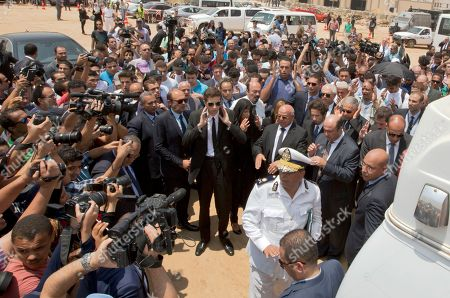 Family members and mourners say funeral prayers in front of an ambulance carrying the body of Egyptian-American Nobel Laureate Ahmed Zewail, during a public funeral ceremony at the site of a science academy founded by Zewail, in 6th of October city, near Cairo, Egypt, . Egypt bid farewell to Ahmed Zewail, who won a Nobel Prize in 1999, according him a military funeral with full honors led by President Abdel-Fattah el-Sissi. Zewail, was a science adviser to President Obama who won the 1999 Nobel Prize for his work on the study of chemical reactions over immensely short time scales