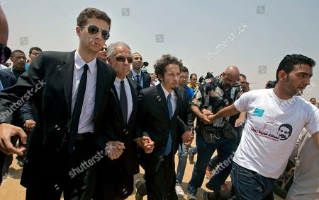 The sons of Egyptian-American Nobel Laureate Ahmed Zewail, Nabil, left, and Hani, third left, lead mourners during a public funeral ceremony at the site of a science academy founded by Zewail, in 6th of October city, near Cairo, Egypt, . Egypt bid farewell to Ahmed Zewail, who won a Nobel Prize in 1999, according him a military funeral with full honors led by President Abdel-Fattah el-Sissi. Zewail, was a science adviser to President Obama who won the 1999 Nobel Prize for his work on the study of chemical reactions over immensely short time scales