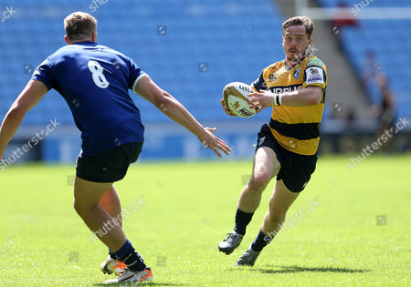 Stock Image of Johnny Lewis of Cardiff Blues runs in to score a try.