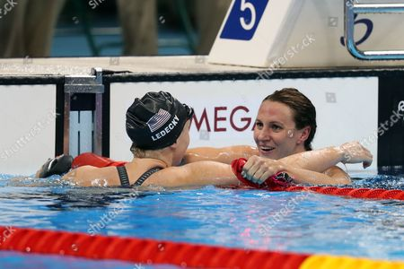 Katy Ledecky of USA celebrates winning the gold and breaking the world record with Jazmin Carlin for Team GB winning the silver in the women's 400m freestyle during day two of the Rio Olympics 2016 on the 7th August 2016