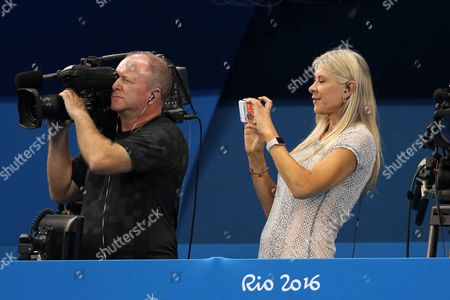 Sharron Davies, former GB Olympian, takes a photo of Adam Peaty with his gold medal during day two of the Rio Olympics 2016 on the 7th August 2016
