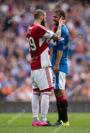 Hamilton's Georgeous Sarris (89) shares a moment with Rangers Niko Kranjcar (19) during the SPFL Premiership match between Rangers and Hamilton Academical at Ibrox Stadium, Glasgow on 6th August
