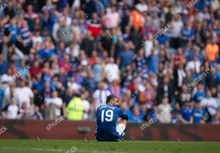Rangers Niko Kranjcar (19) sitting on the pitch during the Ladbrokes SPFL Premiership match between Rangers and Hamilton Academical at Ibrox Stadium, Glasgow on 6th August.