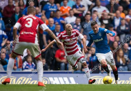 Rangers Michael O'Halloran (29) outpaces Hamilton's Grant Gillespie (6) during the Ladbrokes SPFL Premiership match between Rangers and Hamilton Academical at Ibrox Stadium, Glasgow on 6th August.