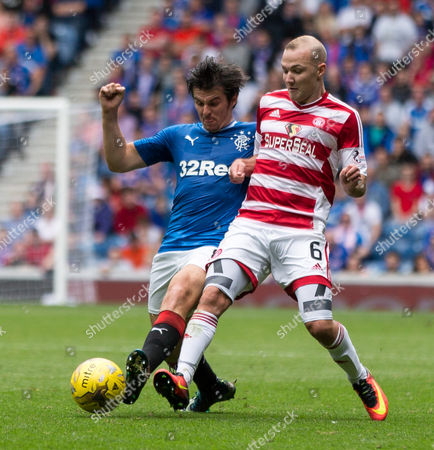 Rangers Joey Barton (8) with Hamilton's Grant Gillespie (6) during the SPFL Premiership match between Rangers and Hamilton Academical at Ibrox Stadium, Glasgow on 6th August