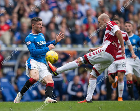 Rangers Michael O'Halloran (29) & Hamilton's Grant Gillespie (6) action during the SPFL Premiership match between Rangers and Hamilton Academical at Ibrox Stadium, Glasgow on 6th August