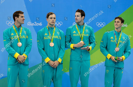 From left, Australia's bronze medal winners James Roberts, Kyle Chalmers, James Magnussen and Cameron McEvoy attend the medal ceremony for the men's 4x100-meter freestyle final during the swimming competitions at the 2016 Summer Olympics, in Rio de Janeiro, Brazil