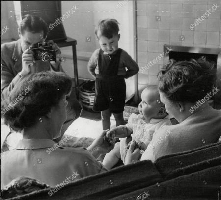Kenneth Moore Take A Photograph Of His Wife Ellen Moore Holding Baby Stephen And Aunt Doris English. (stephen Moore The 'deep Freeze Baby' Now 11 Months Old. His Mother Gave Birth To Him After Being In A Coma And Had Her Body Temperature Lowered By Ice Packs. Box 687 825051624 A.jpg.
