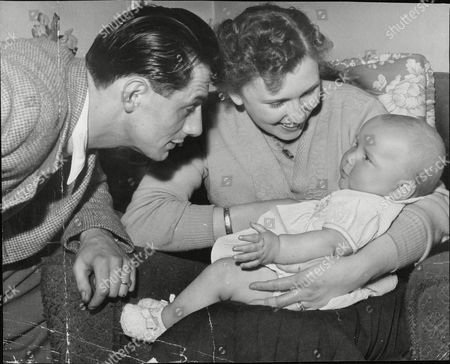 Editorial image of Stephen Moore The 'deep Freeze Baby' Now Aged 11 Months. His Mother Ellen Moore Gave Birth To Him After Being In A Coma And Had Her Body Temperature Lowered By Ice Packs. Picture Shows: Ken And Ellen Moore With Baby Stephen. (for Full Caption See V