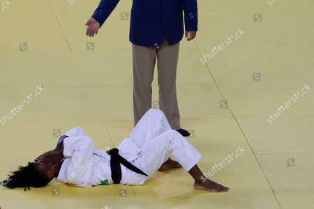 France's Priscilla Gneto reacts after losing to Switzerland's Evelyne Tschopp during the women's 52-kg judo competition at the 2016 Summer Olympics in Rio de Janeiro, Brazil