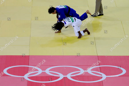 France's Priscilla Gneto competes against Switzerland's Evelyne Tschopp during the women's 52-kg judo competition at the 2016 Summer Olympics in Rio de Janeiro, Brazil