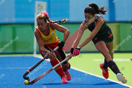 Spain's Georgina Oliva, left, fights for the ball with Netherlands' Naomi Van As during a women's field hockey match at the 2016 Summer Olympics in Rio de Janeiro, Brazil