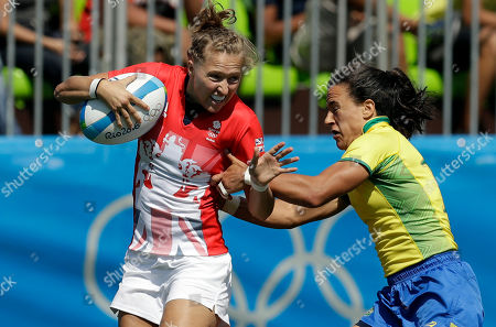 Great Britain's Emily Scott, left, avoids a tackle from Brazil's Isadora Cerullo