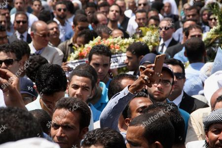 Egyptians attend the second part of the funeral procession of Nobel prize-winning Egyptian-American chemist Ahmed Zewail