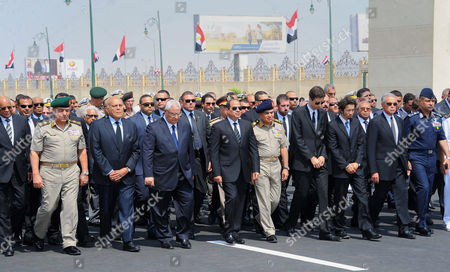 Egyptian President Abdel Fattah al-Sisi walks during a military funeral ceremony with Egyptian government officials and relatives of Egyptian-American Ahmed Zewail