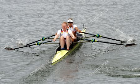 Marie-Catherine Arnold and Mareike Adams, of Germany, compete in the women's double sculls repechage heat during the 2016 Summer Olympics in Rio de Janeiro, Brazil