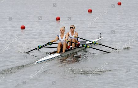 Kristyna Fleissnerova and Lenka Antosova, of the Czech Republic, compete in the women's double sculls repechage heat during the 2016 Summer Olympics in Rio de Janeiro, Brazil