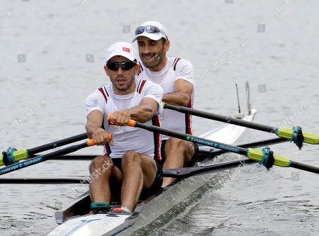 Cem Yilmaz and Huseyin Kandemir, of Turkey, compete in the men's rowing lightweight double sculls heat during the 2016 Summer Olympics in Rio de Janeiro, Brazil