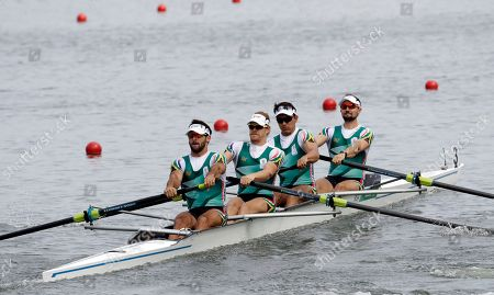 David Hunt, Jonathan Alan Smith, Vincent Breet, and Jake Milton Green, of South Africa, compete in the men's rowing four heat during the 2016 Summer Olympics in Rio de Janeiro, Brazil