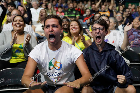 Jack Remmington, Joel Fishel Jack Remmington, left, and Joel Fishel, both of England, cheer for Jia Liu, of Austria, during her table tennis match against Feng Tianwei, of Singapore, at the 2016 Summer Olympics in Rio de Janeiro, Brazil