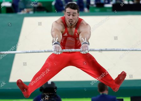 Britain's Kristian Thomas performs on the horizontal bar during the artistic gymnastics men's team final at the 2016 Summer Olympics in Rio de Janeiro, Brazil