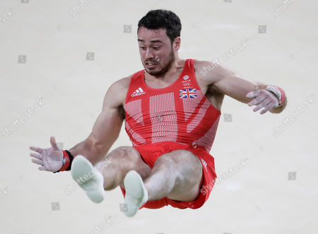 Stock Picture of Britain's Kristian Thomas performs on the floor during the artistic gymnastics men's team final at the 2016 Summer Olympics in Rio de Janeiro, Brazil