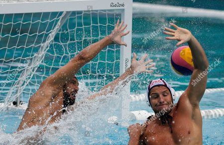 Stock Photo of Merrill Moses United States' goalkeeper Merrill Moses failed to stop a ball during men's water polo preliminary round match against Spain at the 2016 Summer Olympics in Rio de Janeiro, Brazil