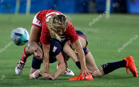 Great Britain's Heather Fisher, bottom, is tackled by Canada's Megan Lukan, during the women's rugby sevens bronze medal match at the Summer Olympics in Rio de Janeiro, Brazil