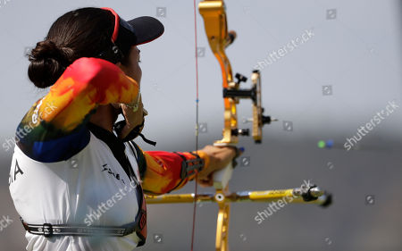 Stock Photo of Colombia's Carolina Aguirre releases her arrow during the women's team archery competition at the Sambadrome venue during the 2016 Summer Olympics in Rio de Janeiro, Brazil