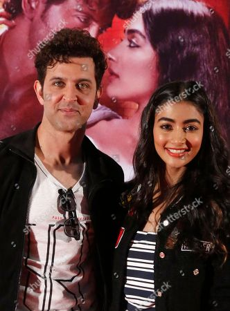 Hrithik Roshan, Pooja Hegde Bollywood actors, Hrithik Roshan, left, and Pooja Hegde pose for photographs during a promotional event for their upcoming movie, Mohenjo Daro, in Ahmadabad, India, . The movie will be released on Aug. 12, 2016
