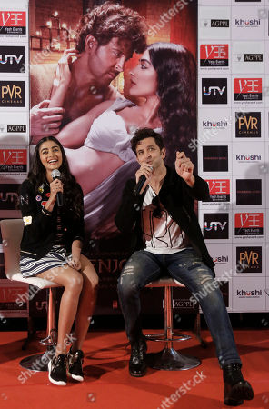 Hrithik Roshan, Pooja Hegde Bollywood actors, Hrithik Roshan, right, and Pooja Hegde talk to journalists during a promotional event for their upcoming movie, Mohenjo Daro, in Ahmadabad, India, . The movie will be released on Aug. 12, 2016