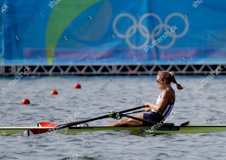 Genevra Stone, of United States, competes in the women's single sculls heat during the 2016 Summer Olympics in Rio de Janeiro, Brazil