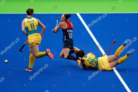 Stock Image of Michelle Kasold, Georgie Parker, Karri McMahon United States' Michelle Kasold, center, is fouled by Australia's Georgie Parker, right, during a women's field hockey match at the 2016 Summer Olympics in Rio de Janeiro, Brazil, . At, left is Australia's Karri McMahon
