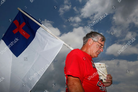 Stock Picture of Ken Scott, of Denver, Colo., a supporter of suspended Chief Justice Roy Moore, prays during a rally in Montgomery, Ala., on . On Monday, a state judicial panel heard oral arguments in the chief justice's motion to dismiss an ethics complaint against him. He is accused of breaking judicial ethics during the fight over same-sex marriage in the state