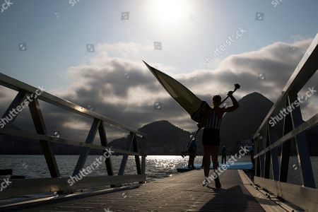 Genevra Stone, of United States, carries her boat before competing in the women's rowing single sculls quarterfinal heats during the 2016 Summer Olympics in Rio de Janeiro, Brazil