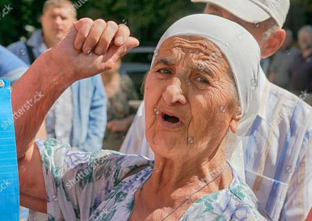A relative of a Ukrainian prisoner of war shouts at a rally near the President's Office in Kiev, Ukraine,. The rally was organized by lawmaker and former prisoner of war Nadezhda Savchenko to urge the authorities to speed up release of the Ukrainian prisoners of war from Russian jails