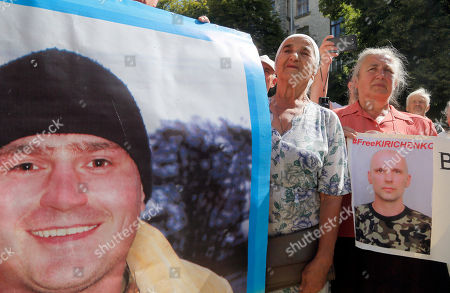 Relatives of Ukrainian prisoners of war hold up their portraits at a rally near the President's Office in Kiev, Ukraine,. The rally was organized by lawmaker and former prisoner of war Nadezhda Savchenko to urge the authorities to speed up release of the Ukrainian prisoners of war from Russian jails