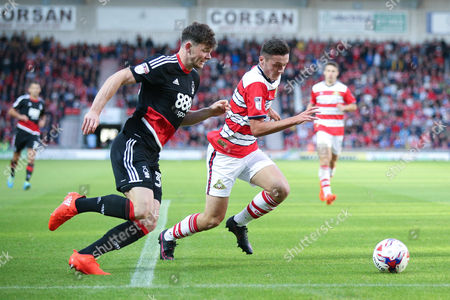 Nottingham Forest midfielder Oliver Burke (35)  takes on Doncaster Rovers defender Tyler Garrett (3)  during the EFL Cup match between Doncaster Rovers and Nottingham Forest at the Keepmoat Stadium, Doncaster