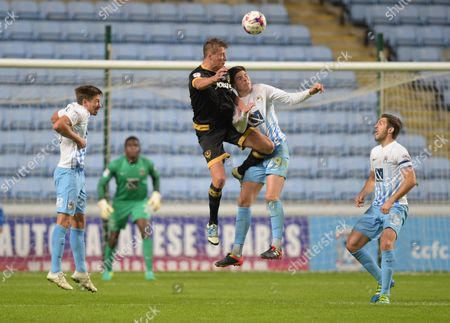 Tom Davies of Portsmouth and Cian Harries of Coventry City during the EFL Cup First Round match between Coventry City and  Portsmouth played at the Ricoh Arena, Coventry on 9th August 2016