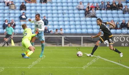 Marcus Tudgay of Coventry City runs into Portsmouth Goalkeeper Alex Bass as Adam Barton gathers up the ball during the EFL Cup First Round match between Coventry City and  Portsmouth played at the Ricoh Arena, Coventry on 9th August 2016