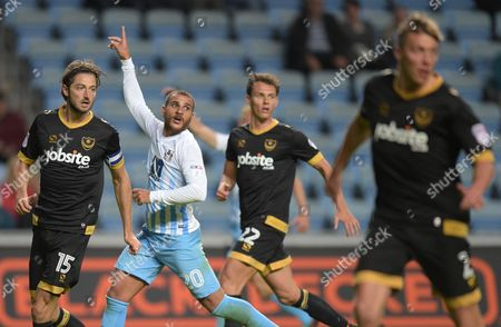 Adam Barton of Portsmouth and Marcus Tudgay of Coventry City during the EFL Cup First Round match between Coventry City and  Portsmouth played at the Ricoh Arena, Coventry on 9th August 2016